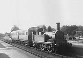 GWR �517� class 0-4-2T No.1157 with auto trailer No.76 waiting to depart from the platform at Alcester for Bearley