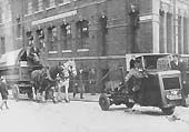 A GWR Karrier Cob Mechanical Horse acting as the 'Chain Horse' in Pitsford Street with a two horse tilt van