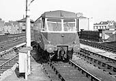 An unidentified ex-GWR Railcar is seen arriving wrong road at Leamington's up platform circa late 1950s