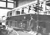 GWR Streamlined Diesel Railcar No 3 with engine covers removed in the Tyseley Repair Shop on a Saturday in 1935