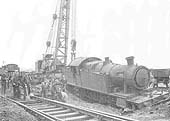 View of GWR 2-8-2T No 7238 after running in to a Luftwaffe bomb crater at Budbrook near Hatton on 17th May 1941