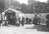 Temporary garage facilities erected for Warwick Royal Show with Fordson tractor No 2313 under repair