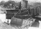 Photograph of a rake of derailed loose coupled Newdigate Colliery wagons lying in Coventry Canal on 21st May 1885