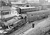 Ex-LMS 3MT 2-6-2T No 40135 is seen with a derailed 57 ft ex-LMS brake adjacent to Coventry No 2 Signal box on 21st November 1959