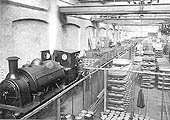 View of inside the Shell Shop at White & Poppe's factory in Holbrooks as workers are seen loading shell cases into wagons ready to be transported to be filled with explosive