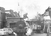 Peckett 0-4-0ST Works No 1722 'Rocket' is seen working a train of coal wagons through Courtaulds factory in March 1969