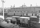 Close up showing Great Western Railway rolling stock passing behind the GWR station on 26th May 1925