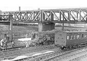 Ex-LMS 4-6-0 Black 5 No 44716 is seen lying derailed under the GC bridge on the down line from Euston