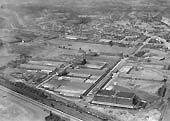 Last of five aerial photographs showing the Fort Dunlop factory and sidings together with the adjacent railway