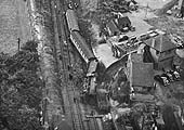 Close up showing the severely damaged railway track and the locomotive No 45699 'Galatea' lying on its side