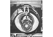 View of the Ro-Railer's later modified wheel lift system with the road wheel in the raised position