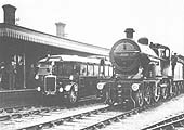 The Ro-Railer is standing at the up platform whilst ex-MR 4-4-0 No 556 stands on the middle road