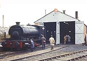 The 'Foleshill Railway Company' flag flutters above railway enthusiasts inspecting the locomotive shed